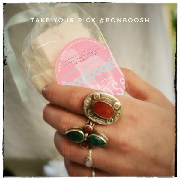Female hand with rings on fingers holding a pack of Bonboosh Candfloss Marshmallows
