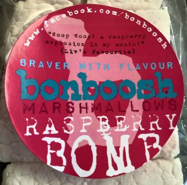 Close up of raspberry bomb package label with large marshmallows hidden behind